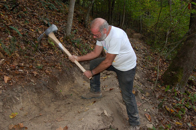 Volunteer Jim Runk helps build a new section of the Buckeye Trail. Photo by Mary Reed.